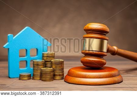 Divorce By Law. Division Of Property After A Divorce. House With Money And A Judge Gavel
