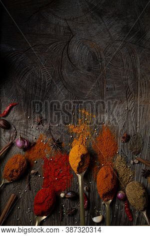 Condiment Of Indian Food Spice Garnish Background On Wood Table Top View. Seasoning Of Asian Organic