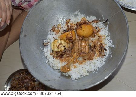 Delicious Spicy Homemade Chicken Biryani Making In Bowl By An Indian Woman. It's A Popular Indian An