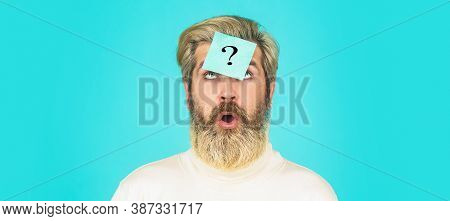 Man With Question Mark On Forehead Looking Up. Paper Notes With Question Marks. Beard Man Question M