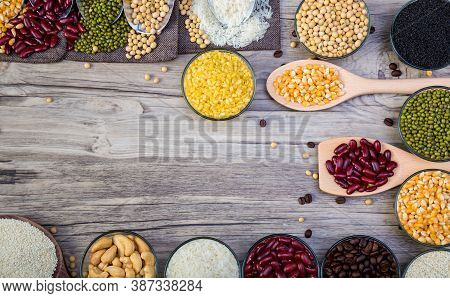 Cereal Grains Seeds Beans On Wooden Background. Whole Grains And Bean. Cereals And Beans. Different