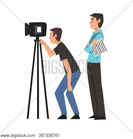 M Cameraman Shooting With Video Camera On Tripod, Anchorman Standing Next To Him, Television Industr