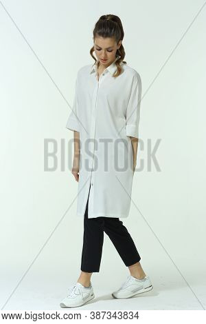 Business Woman In Official Formal Clothes Trousers And Saggy White Blouse