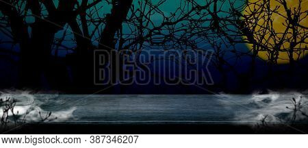 Halloween Background. Smoke On Grunge Wood Table At Spooky Dead Tree And Full Moon In Blue Gradient