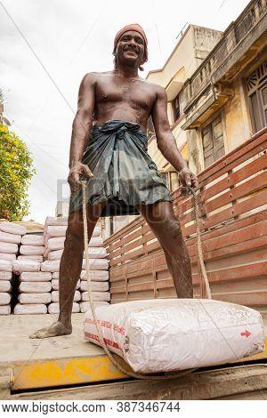 Chennai, Tamil Nadu, India - Portrait Of A Sweaty Hard Working Indian Manual Labor Construction Work