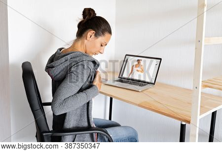 Caucasian Woman Doing Self Breast Check Up By Online Tutorial With Doctor.