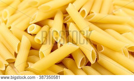 Penne Rigate Raw Pasta Is A Short Pasta With Oblique Cuts And A Ribbed Surface. Traditional Italian