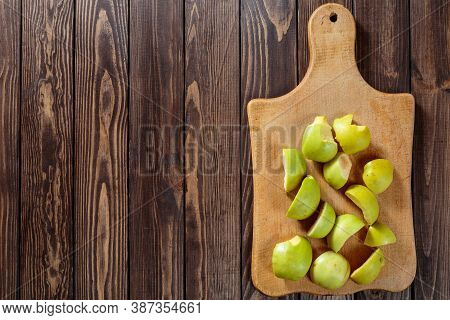 Making Apple Pie. Peeled And Chopped Apples On A Cutting Board. Chopped Green Apples For Fruit Salad