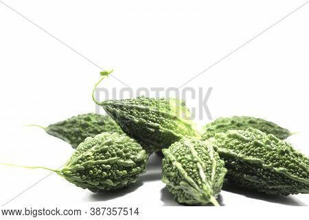 Bitter Gourd, Rough, Green, Organic, Edible And Herbal, With A Bitter Taste On A White Background.