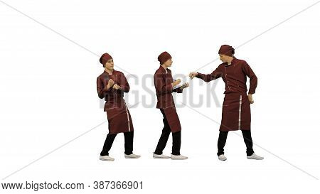 Two Funny Cooks In Red Uniform Following Bossy Head Cook Writing