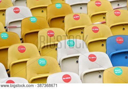 Kyiv, Ukraine - August 5, 2020: Seats With Covid-19 Quarantine Labels Seen On The Tribunes Of Nsc Ol
