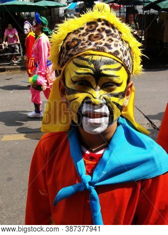 Bangkok, Thailand, November 14, 2015: A Boy With A Painted Face And A Colorful Dress In The Parade O