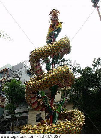 Bangkok, Thailand, November 14, 2015: Several Boys Climb A Dragon To A Mast During The Parade Of A F