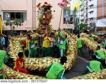 Bangkok, Thailand, November 14, 2015: A Group Of Boys Make A Big Dragon Dance In A Festival Of The C
