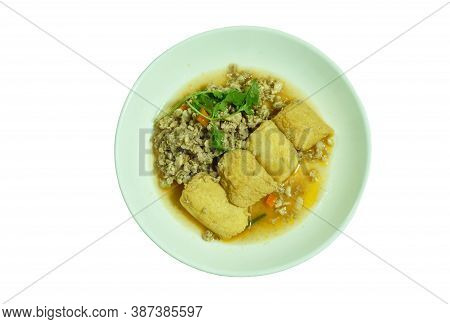 Deep Fried Egg Tofu With Chop Pork In Sweet And Sour Gravy Sauce On Plate