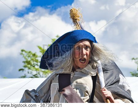Yainville, France - July Circa, 2019. Actor Man In Historical Pirate Costume Making A Show Outdoors,