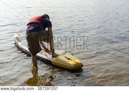 Standup Paddleboarding Are On The River Moscow, Strogino.