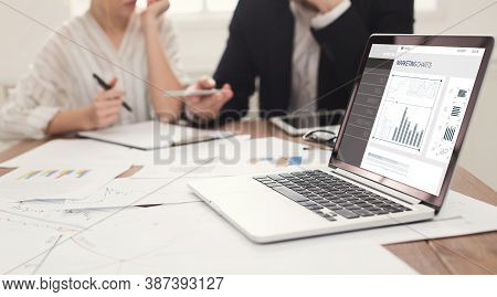 Online Marketing. Two Internet Marketers Working On Laptop Creating E-business Promotion Strategy Si