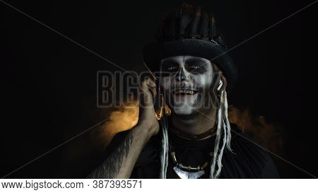 Scary Guy In Thematic Carnival Costume Of Halloween Skeleton Wearing Earphones, Listening Music, Dan