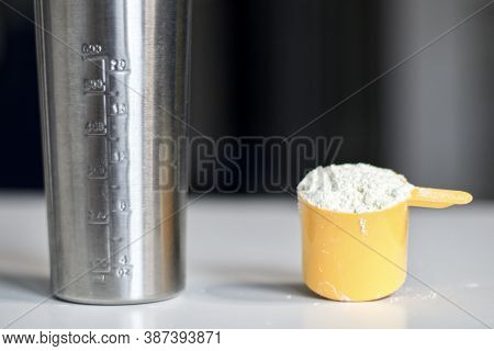 Scoop Of Whey Protein, Sports Nutrition, Supplement With Shaker For Cocktail. Food For Gain Muscles