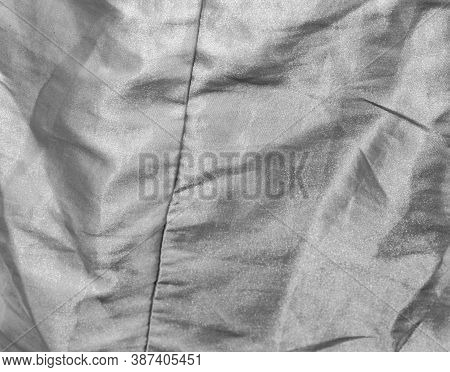 Abstract Background Of White Fabric Is Creased. Texture Of Fabric Creased In Black And White Tone.