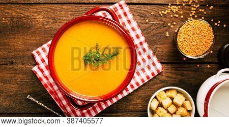 Delicious Lentil Soup On A Wooden Table. Vegetarian Cuisine