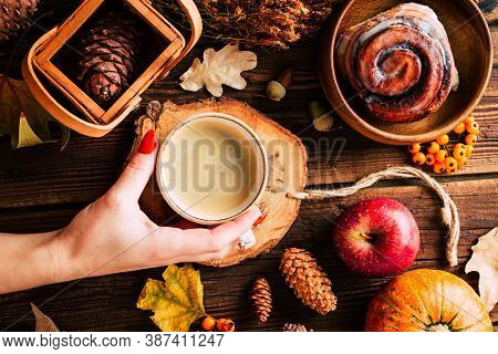 Autumn Concept. Delicious Cappuccino On A Wooden Background Among Fallen Leaves.