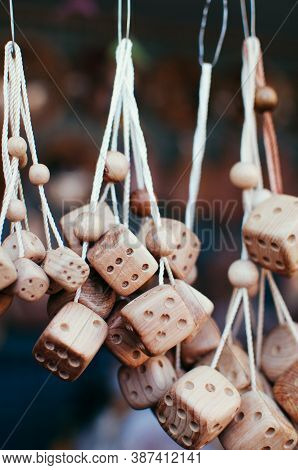 Souvenirs - Wooden Dice For Game On A Cord