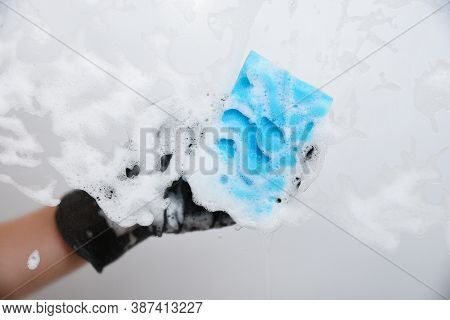 Window Cleaning Washer Closeup. Hand With Black Glove. Householdind Work Concept