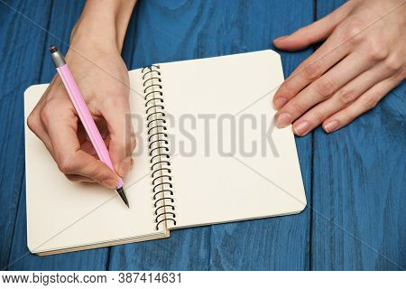 Girl Writing In Notebook, Over Head View
