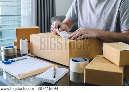 Young Entrepreneur Sme Man Receive Order Client And Working With Packaging Sort Box Delivery Online