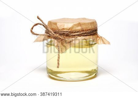 Jar With Organic Light Oil On White Background