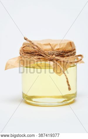 Jar Oil With A Paper Lid And Rope