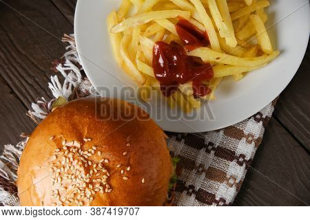 Tasty Fast Food Burger With Beef And Potato On White Plate