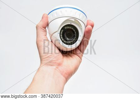 Dome Round Surveillance Camera In Male Hand