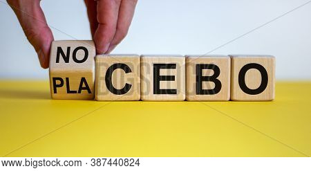 Nocebo Or Placebo. Hand Turns A Cube And Changes The Word 'placebo' To 'nocebo', Or Vice Versa. Beau