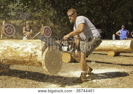 WEST POINT, CA - OCTOBER 6: Unidentified competitor in the men's chainsaw log cutting event at the Lumberjack day, on October 6, 2012 in West Point. West Point celebrates it's 38th Lumberjack day.