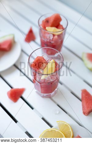 Fresh Summer Watermelon Drink In Glass And Piece Watermelon On Wooden Board. Colorful Cool Drinks Fo