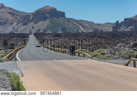 Spain, Tenerife - 05/10/2018: Mountain Landscape.a Winding Mountain Highway Disappears Over The Hori