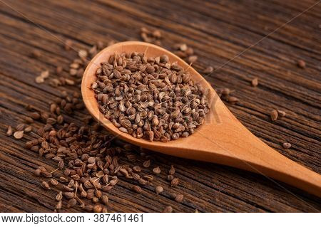 Anise Seeds In A Wooden Spoon On The Table. Anise Seeds Close Up.