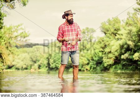 Calm And Peaceful Mood. Fisherman Alone Stand In River Water. Man Bearded Fisherman. Fisherman Fishi