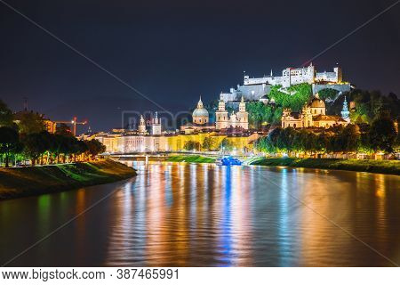 Salzburg city shining in the lights at night. Location place Festung Hohensalzburg, Salzburger Land, Austria, Europe. Photo of popular tourist attraction of the world. Discover the beauty of earth.