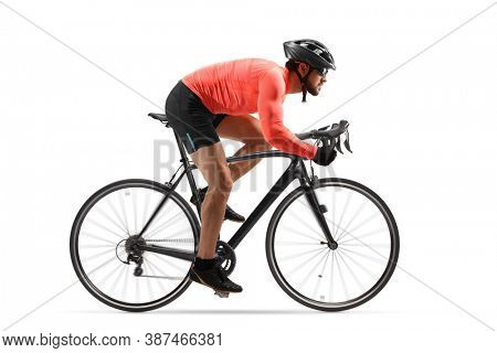 Profile shot of a male cyclist riding a road bicycle with spinning wheels isolated on white background