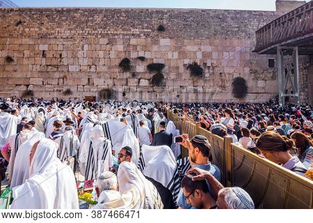 JERUSALEM, ISRAEL - SEPTEMBER 26, 2018: Blessing of the Kohanim. Women praying at the Wailing Wall behind the fence. The area in front of Western Wall of Temple filled with people