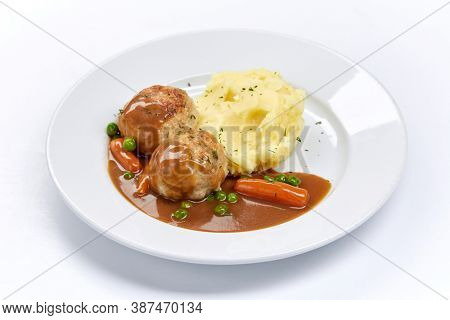 meatballs with mashed potato and vegetables