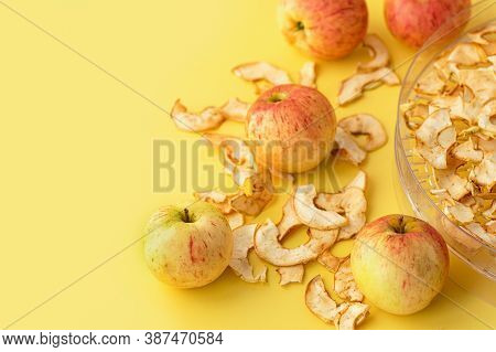 Apples And Electronic Dehydrator Dryer On A Yellow Background. Preserving Fresh Fruit By Drying. Clo