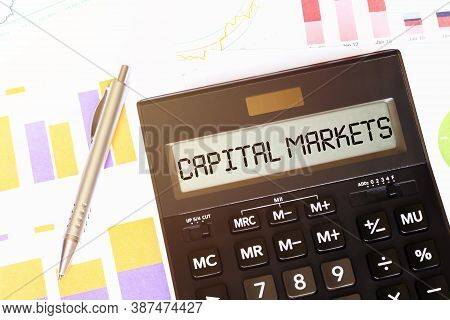 Word Capital Markets On Calculator. Business And Tax Concept
