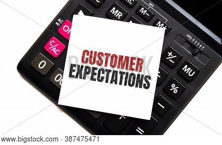 Calculator With Text Customer Expectations With White Paper