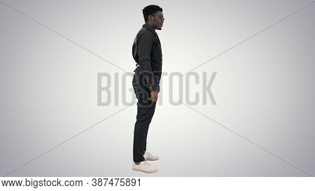 Young African American Businessman In Glasses Standing And Pulli