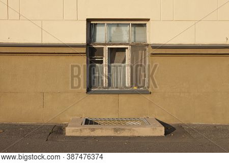 Old Wooden Framed Window On The Ground Floor. The Window Is Not High Above The Ground. Housing Of A